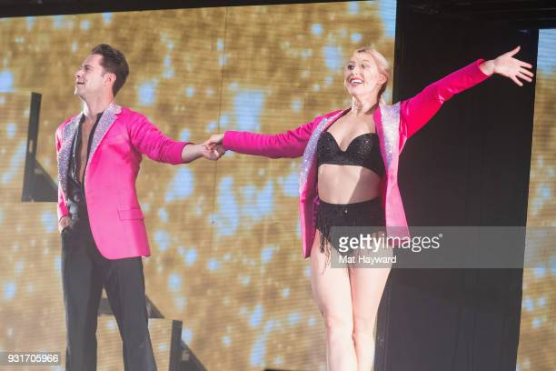 Dancers Emma Slater and Sasha Farber perform on stage during Dancing With The Stars Live at WaMu Theater on March 13 2018 in Seattle Washington