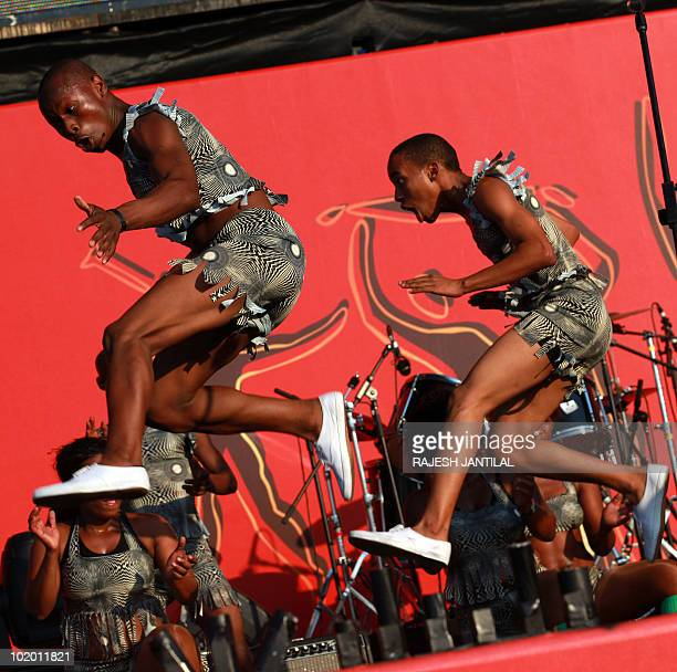 Dancers entertain hundreds of fans as they attend a Fanfest at the New North Beach in Durban on 12 June 2010 to watch the soccer match between...