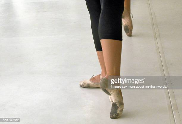 dancers feet in old dirty sneakers rehearsing. - images of ugly feet stock photos and pictures
