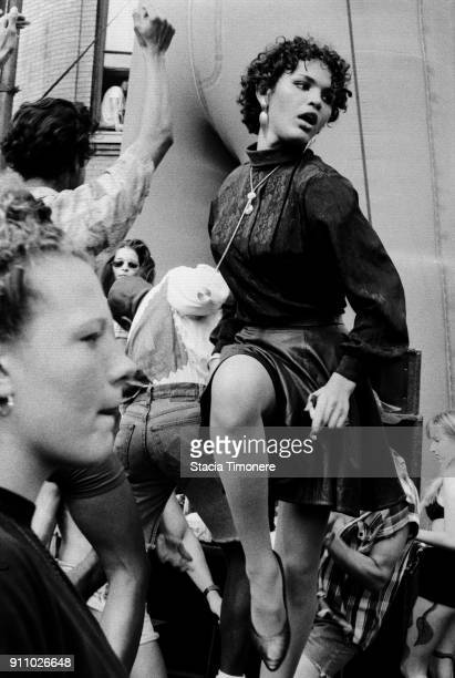 Dancers flank Halsted Street during the annual street fair in Chicago Illinois United States on August 6 1991