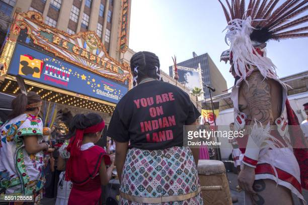 Dancers from Anahuacalmecac International University Preparatory of North America school for indigenous students pray before dancing on Hollywood...