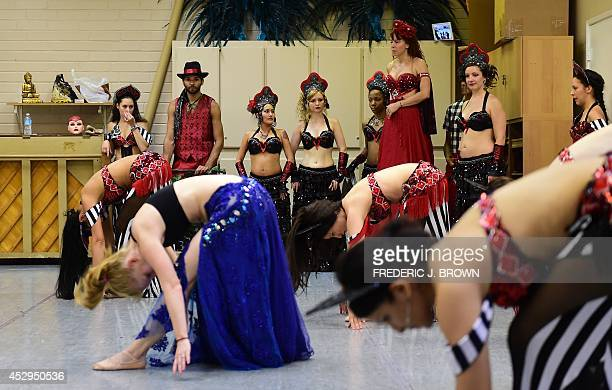 Dancers from Bellydance Evolution go through a final full rehearsal on July 30 2014 at a dance studio in North Hollywood California for a performance...