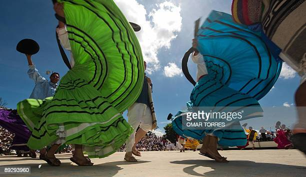 Dancers from Ixtepec city perform during the Guelaguetza celebration on July 27 2009 in Oaxaca Mexico The Guelaguetza which in Zapotec languaje means...
