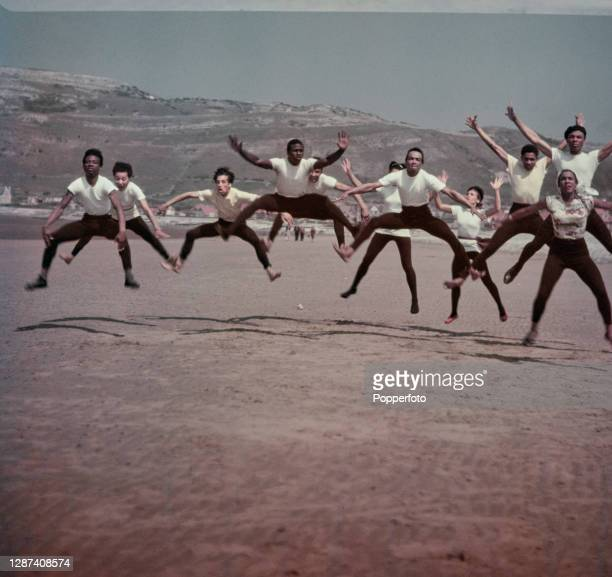 Dancers from Les Ballets Negres, Europe's first black dance company, rehearse on the beach at the seaside resort town of Llandudno in Wales in July...