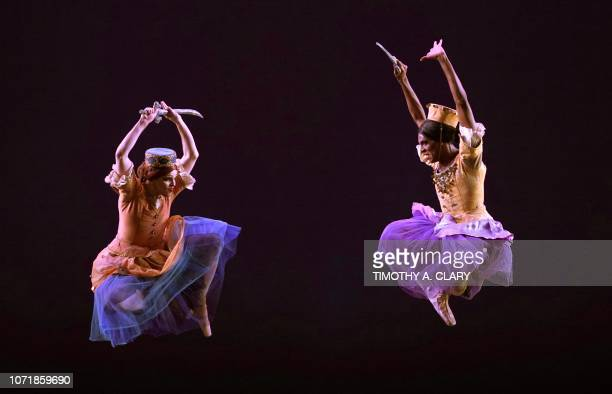 TOPSHOT Dancers from Les Ballets Trockadero de Monte Carlo perform a scence from Trovatiara during a dress rehearsal December 11 2018 before opening...