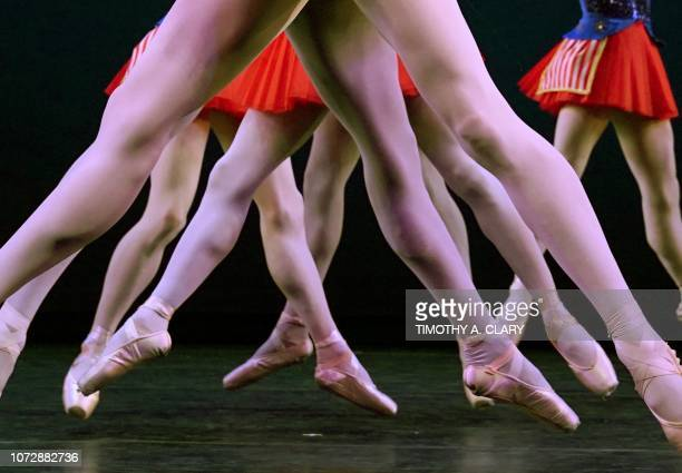 Dancers from Les Ballets Trockadero de Monte Carlo perform a scence from Stars Stripes Forever during a dress rehearsal December 13 2018 at the Joyce...