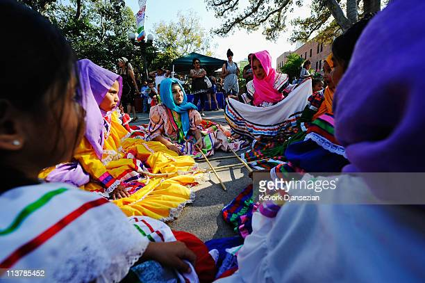 Dancers from Mexica Ballet Folclorico wiat to perform during Cinco De Mayo festivities on May 5 2011 at El Pueblo de Los Angeles Historic Site on...