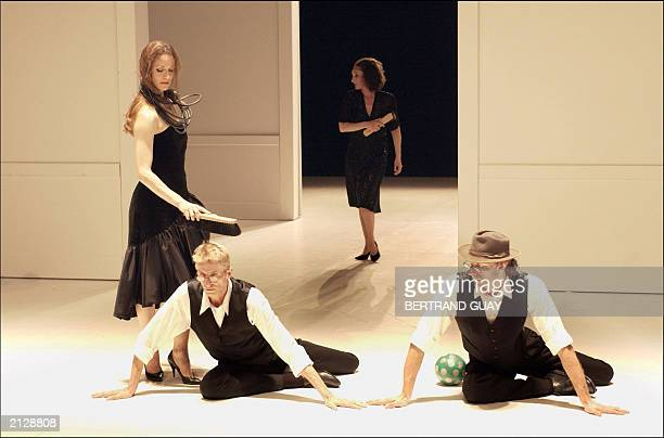 Dancers from Pina Bausch Tanztheater Wuppertal perform 17 June 2003 in Paris' Theater de la Ville an erotic expressionist creation written and...
