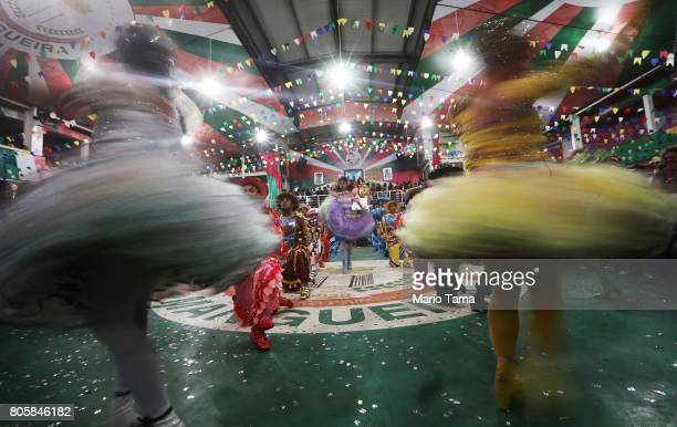 Dancers from PodeC Show perform during a traditional Festas Juninas party at the Mangueira samba school located in the Mangueira favela community on...