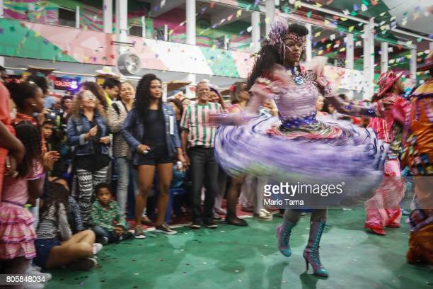 Dancers from PodeC Show perform during a traditional Festas Juninas party at the Mangueira samba school located in the Mangueira ÔfavelaÕ community...
