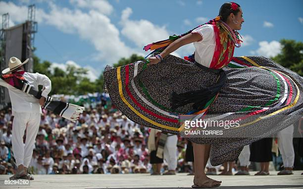 Dancers from San Pedro Ayutla perform during the Guelaguetza celebration on July 27 2009 in Oaxaca Mexico The Guelaguetza which in Zapotec languaje...