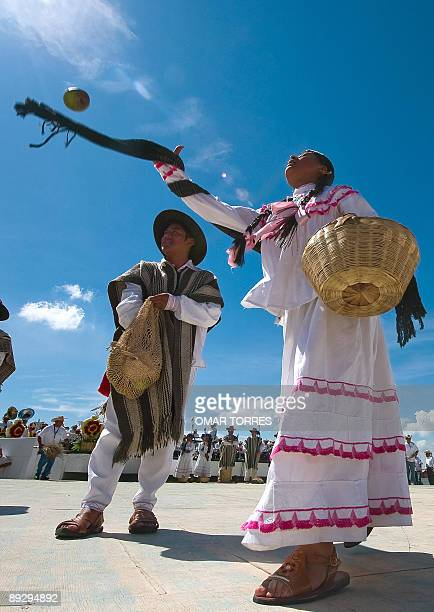 Dancers from San Pedro Ayutla throw fruits to spectators during the Guelaguetza celebration on July 27 2009 in Oaxaca Mexico The Guelaguetza which in...