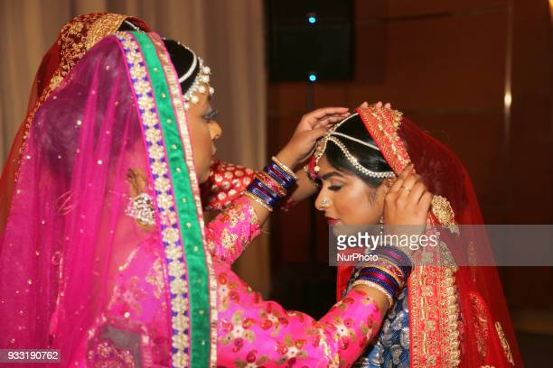 Dancers from Sathangai Narthanalaya prepare before performing a traditional dance to the Ghoomar song from the Bollywood film Padmaavat during the...