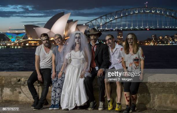 Dancers from Sydney's Dance Central pose for a photo with the harbour background before their flash mob Thriller dance performance during the 'Light...