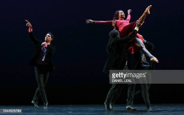 Dancers from the Acosta Danza company including Carlos Acosta and Marta Ortega perform during a press preview of Christopher Bruce's 'Rooster' at the...