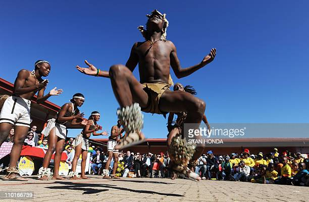 Dancers from the Anuma group perform a Botswanan Cultural Dance during a presentation of lapdesks donated by the Football Federation Australia to...