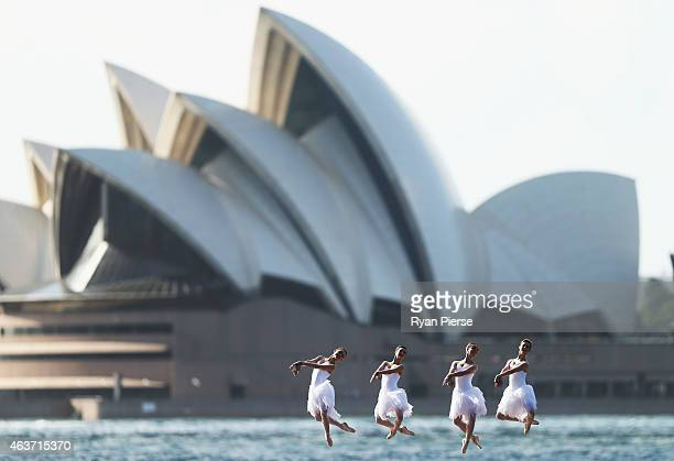 Dancers from The Australian Ballet pose in white swan costumes ahead of the opening of Swan Lake on Sydney Harbour on February 18 2015 in Sydney...