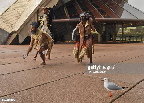 Dancers from the Bangarra Dance Theatre Daniel Riley Beau Dean Riley Smith and Elma Kris perform on the steps of the Sydney Opera House on June 28...