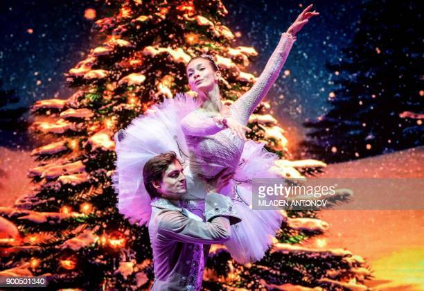 Dancers from the Boshoi Theatre ballet perform on Tverskaya street during a festival marking the New Year and Christmas in central Moscow on January...