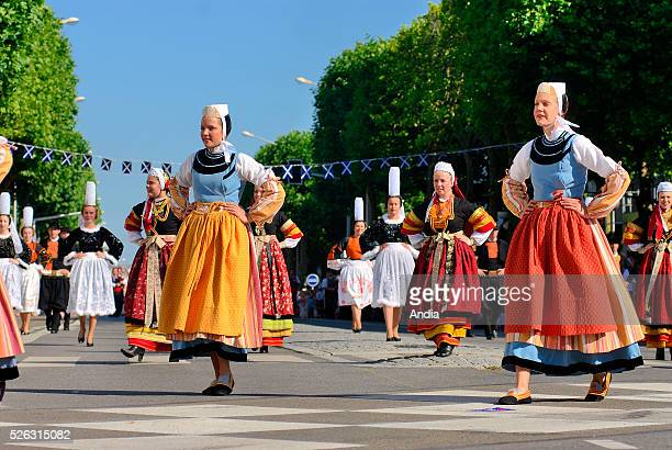 Dancers from the Celtic circle dance group Ar Vro Vigouden from PontLabbe attending the Grand Parade of Celtic Nations of the 'Festival Interceltique...