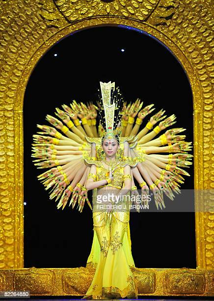 Dancers from the China Disabled People's Performing Art Troupe perform the Thousandhand Avalokitesvara Bodhisattva or Guan Yin dance on stage in...
