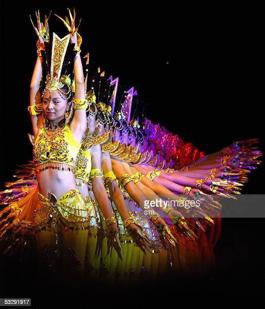 Dancers from the China Disabled Person's Performing Art Troupe perform the Thousandhand Goddess of Mercy dance late 25 July 2005 in Kunming in...