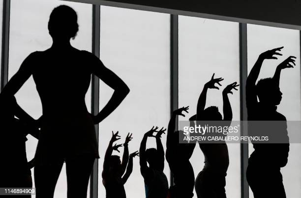 Dancers from the Dance Theatre of Harlem and the Collage Dance Collective rehearse during a preview for the media of the REACH an expansion project...