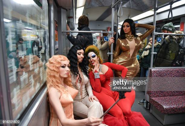 Dancers from the Friedrichstadt Palast revue who portray celebrities such as Madonna Conchita Wurst Divine and Kim Kardashian react in a subway on...