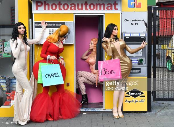 Dancers from the Friedrichstadt Palast revue who portray celebrities such as Conchita Wurst Divine Madonna and Kim Kardashian pose during a photo...