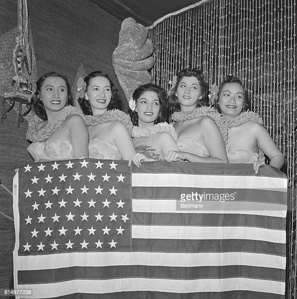 Dancers from the Hawaiian Room of the Hotel Lexington here pose with an American flag containing 50 stars The House passed the Hawaiian statehood...