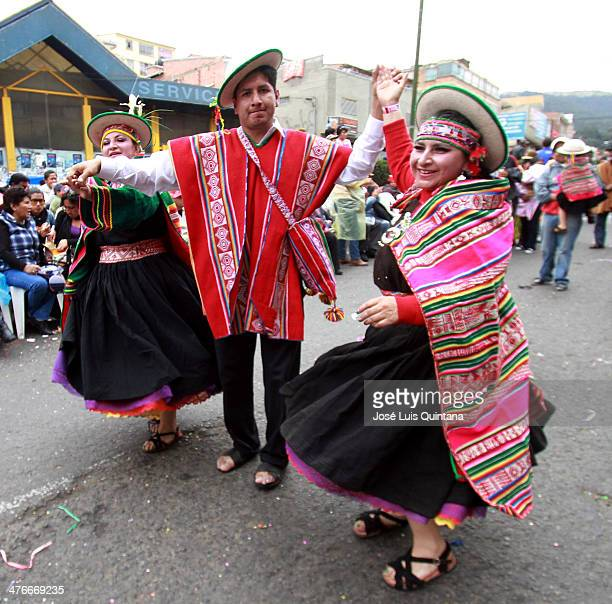 Dancers from the Kantus de Charazani community dance 'Zampoñada' during the traditional Andean parade Jiska Anata at the beginning of the Festival on...