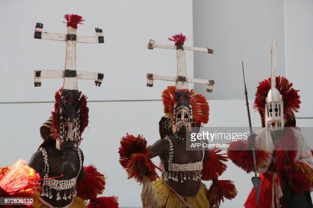 Dancers from the Malian Troupe Awa de Sangha perform during the opening of the Louvre Abu Dhabi Museum on November 11 2017 on Saadiyat island in the...