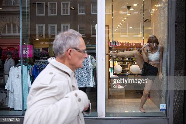 Dancers from the Royal Opera House perform a piece entitled 'Windows in Progress' which takes place in and around various shops adjacent to the Opera...
