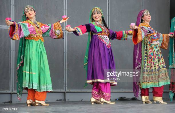 Dancers from the Silk Road Dance Company perform a traditional dance in Toronto Ontario Canada The Silk Road Dance Company enthralled the large...
