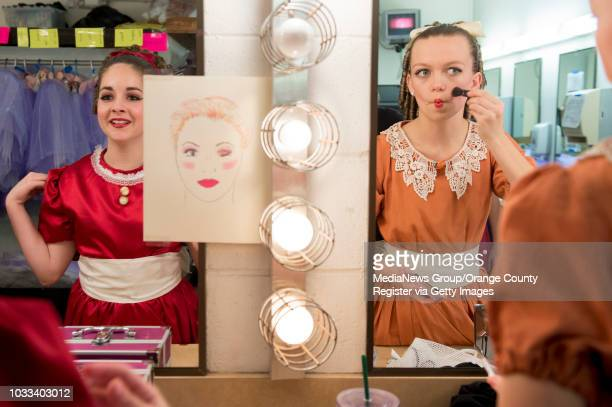 Dancers Gabriela Garcia left and Nicole Follmer make last minute makeup applications as they prepare to perform Friday night in the Laguna Ballet's...
