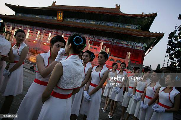 Dancers get ready for the Award-giving Ceremony for the 4th Olympic Songs Competition at the Worker People's Cultural Palace, the Imperial Ancestral...