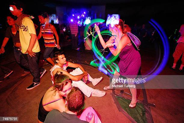 Dancers 'glowstick' at the 11th annual Electric Daisy Carnival massive rave held at the Los Angeles Coliseum on June 30 2007 in Los Angeles California