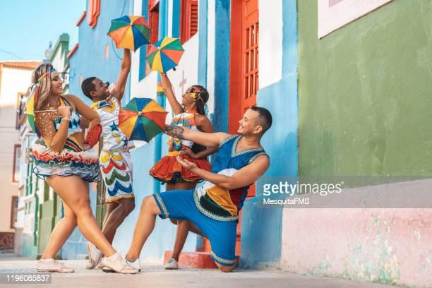 dancers group performing at street - frevo imagens e fotografias de stock