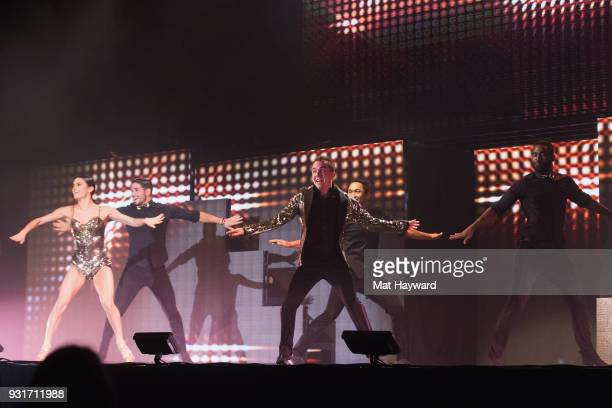 Dancers Hayley Erbert Alan Bersten Frankie Muniz Brandon Armstrong and Keo Motsepe perform on stage during Dancing With The Stars Live at WaMu...