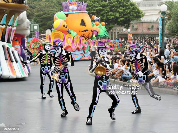 Dancers in clad of skeleton perform during the preview of the Halloween parade at Tokyo Disneyland in Urayasu, suburban Tokyo on September 7, 2017....
