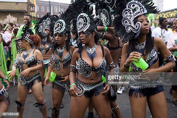 Dancers in colorful and revealing costumes perform during the Notting Hill Carnival This is an annual event which has taken place on the streets of...