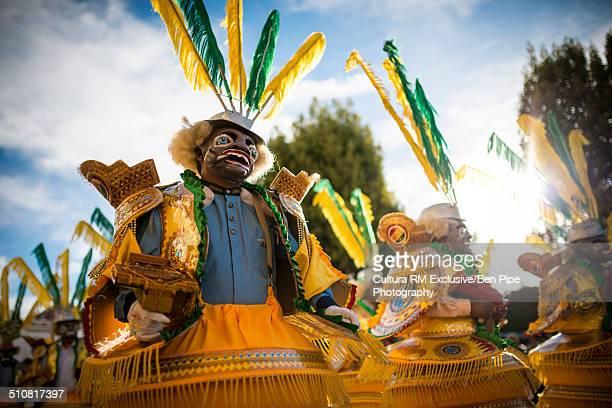 dancers in masks and costumes, fiesta de la virgen de la candelaria, copacabana, lake titicaca, bolivia, south america - fiesta de la virgen de la candelaria fotografías e imágenes de stock