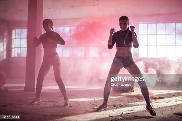 Dancers in pink smoke