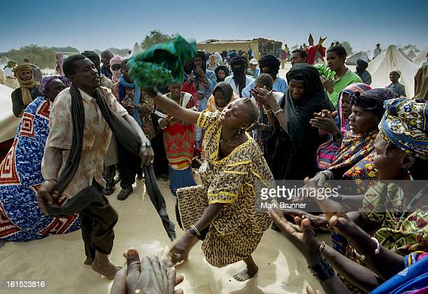 """Dancers in the camps at """"festival au desert in 2005. During the night the music was on the stage but always there were inpromptu jam seesions in the..."""