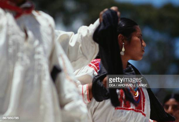Dancers in traditional costumes during the celebrations at the Guelaguetza festival Oaxaca Mexico