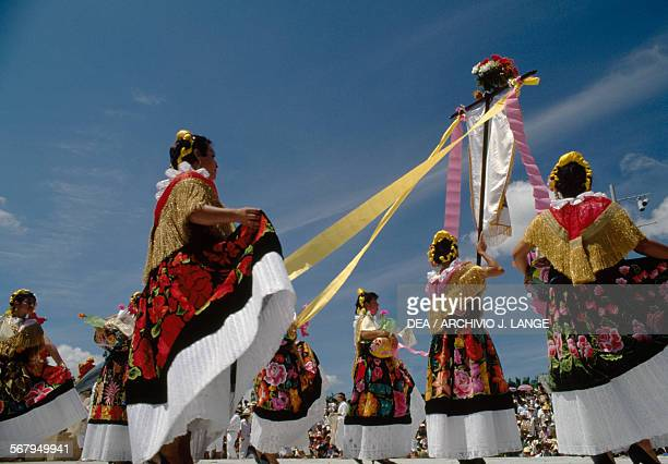 Dancers in traditional costumes Guelaguetza festival Oaxaca Mexico