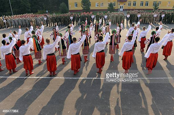 Dancers in Ukrainian national costumes perform during the opening ceremony of the Rapid Trident military exercises on September 15 2014 near Yavoriv...
