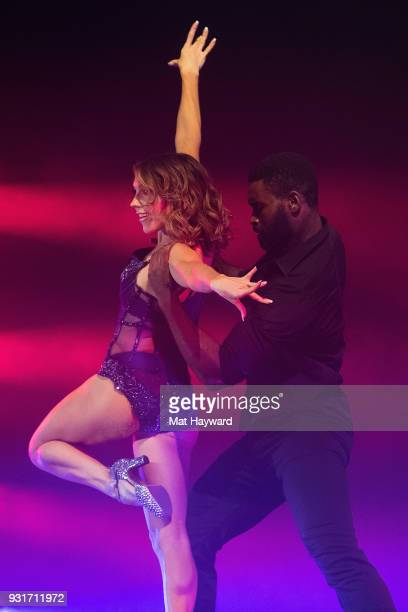 Dancers Jenna Johnson and Keo Motsepe perform on stage during Dancing With The Stars Live at WaMu Theater on March 13 2018 in Seattle Washington