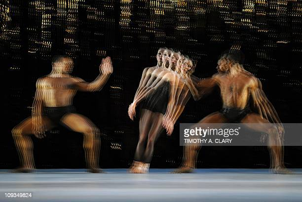 Dancers Joseph Watson Emily Procter and William Cannon from the Aspen Santa Fe Ballet perform a scene from Stamping Ground during a dress rehearsal...