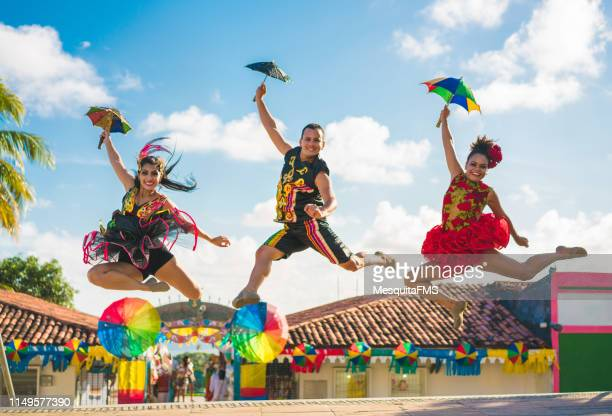 dancers jumping in the brazilian carnival - recife stock pictures, royalty-free photos & images